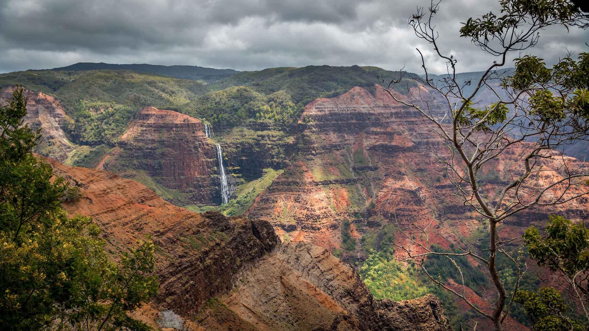 88544486 - waipoo falls in waimea canyon, kauai, hawaii.